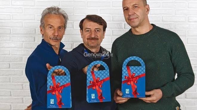Aldo, Giovanni e Giacomo con i cioccolatini della ricerca Airc
